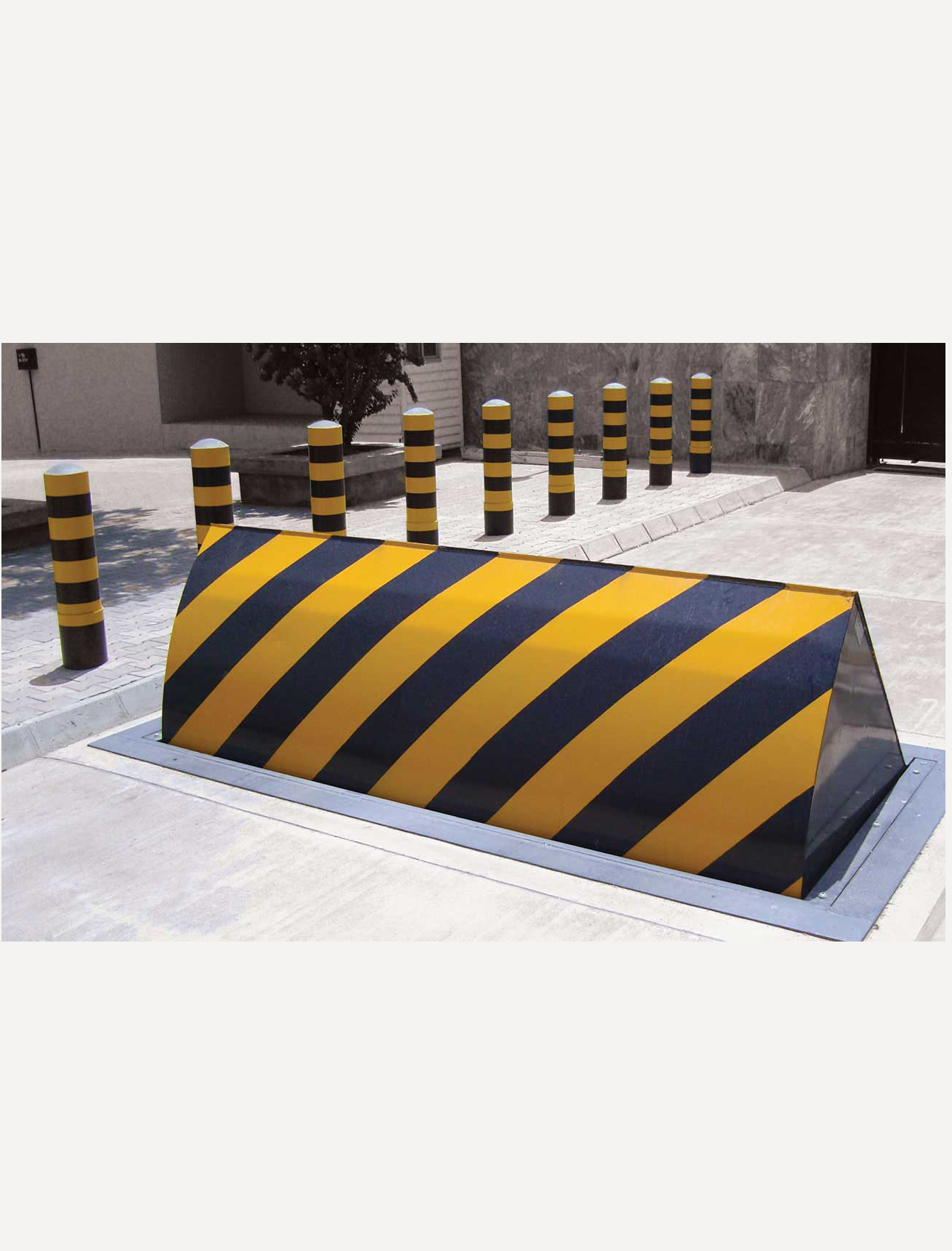 K12 hydraulic ram barrier by crimsafe bollards.