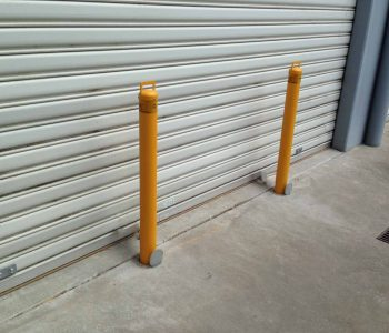 Roller door protection warehouse protection crime safe bollards.